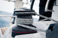 Sailing boat winch with rope closeup stock images