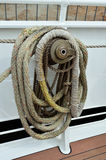 Sailing boat winch and ropes. Close up of a sailing boat winch with fiber ropes Stock Photos