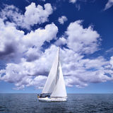 Sailing boat in the wind stock photo