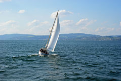 Sailing boat wind on a lake Royalty Free Stock Image