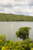 Sailing boat Windermere Lake District Cumbria UK on beautiful peaceful relaxing summer day Royalty Free Stock Photo