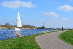 Sailing boat and windmill Stock Photography