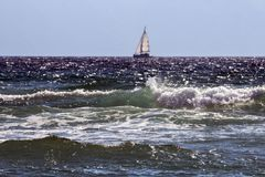 Free Sailing Boat With Sunlit Waves Stock Photography - 99685782