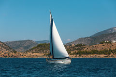 Sailing boat yacht on blue water Sea. Travel. Sailing boat yacht on blue water Sea Stock Photo