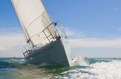 Sailing Boat Yacht. Close up of sailing boat, sail boat or yacht at sea on summer's day with blue sky Stock Photos