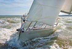 Sailing Boat Yacht. Close up of sailing boat, sailboat or yacht at sea with white sails royalty free stock photo