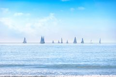 Sailing boat yacht regatta race on sea or ocean water Stock Photos