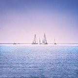 Sailing boat yacht regatta race on sea or ocean water Royalty Free Stock Image