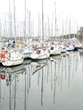 Sailing Boats. And their reflection in a harbour Stock Photo