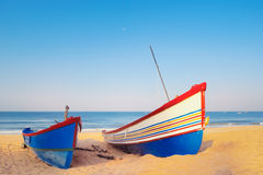 Sailing Boats. Two sailing boats on the sandy beach Stock Images