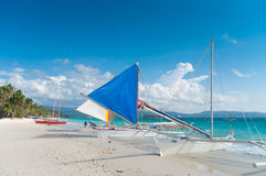 Sailing boats. Traditional paraw sailing boats on the famous white beach on Boracay island, Philippines Stock Photo