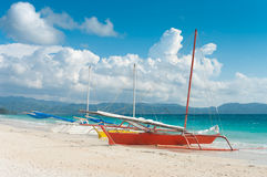 Sailing boats. Traditional paraw sailing boats on the famous white beach on Boracay island, Philippines Royalty Free Stock Image