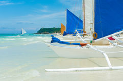 Sailing boats. Traditional paraw sailing boats on white beach on boracay island, Philippines Stock Photos