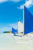 Sailing boats. Traditional paraw sailing boats on white beach on boracay island, Philippines Stock Photography