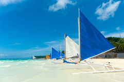 Sailing boats. Traditional paraw sailing boats on white beach on boracay island, Philippines Royalty Free Stock Photos