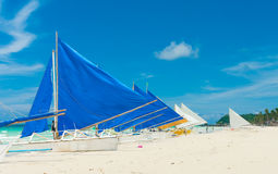 Sailing boats. Traditional paraw sailing boats on white beach on boracay island, Philippines Royalty Free Stock Photography