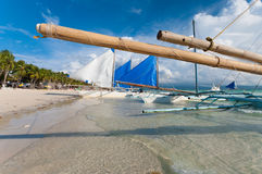 Sailing boats. Traditional Philippine paraw sailing boats on the famous white beach on Boracay Stock Photo