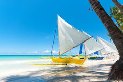 Sailing boats. Traditional paraw sailing boats on white beach on boracay island, Philippines Stock Images