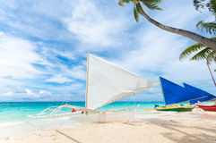 Sailing boats. Traditional paraw sailing boats on white beach on boracay island, Philippines Royalty Free Stock Image