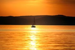 Sailing boats with a beautiful sunset Royalty Free Stock Photo