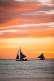 Sailing boats with a beautiful sunset at the sea Royalty Free Stock Photography