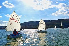 Sailing boats cadets racing. Kids racing in class Optimist sailboats regatta on Iskar Lake,Sofia Bulgaria. Picture taken on October 14th 2017 Stock Image