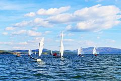 Sailing boats cadets racing. Kids racing in class Optimist sailboats regatta on Iskar Lake,Sofia Bulgaria. Picture taken on October 14th 2017 Royalty Free Stock Image