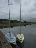 Sailing boats in calm moorings, Ireland Stock Image