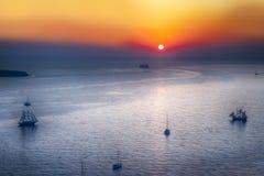 Sailing Boats and Cruise Ships Near Santorini Island at Dusk. Sailing Boats and Cruise Ships Near Santorini Island at Dus. Picture Taken at Golden Hour stock photo
