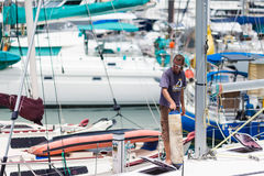 Sailing boats docked. At the shore,seaman standing on the boat.Langkawi Island,Malaysia Stock Images