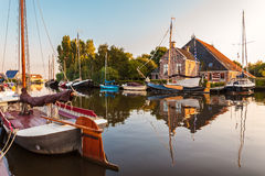 Sailing boats in the Dutch province of Friesland. During sunset Stock Image