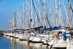 Sailing boats at harbour against clear blue sky stock photos