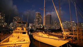 Sailing boats Honolulu. Waikiki, Oahu, Hawaii - August 20, 2016: panorama of sailing boats docked at the Ala Wai Harbor at twilight the largest yacht harbor of stock footage