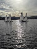 The sailing boats on the lake stock photos