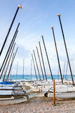 Sailing boats lay on the sandy beach in Calafell Royalty Free Stock Images
