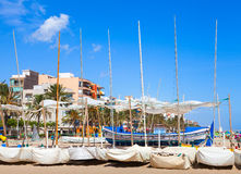 Sailing boats lay on the sandy beach Stock Images