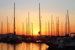 Sailing boats in marina at sunset Royalty Free Stock Photography