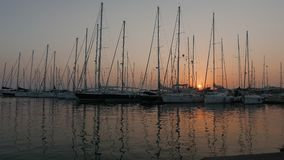 Sailing boats in marina at a sunset 4k stock video footage