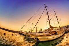 Sailing boats in marina at sunset. Royalty Free Stock Photo