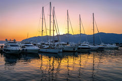 Sailing boats in marina at sunset. Royalty Free Stock Photo
