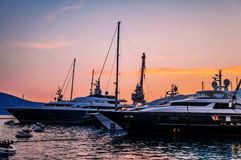 Sailing boats in marina at sunset. Stock Image