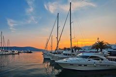 Sailing boats in marina at sunset. Royalty Free Stock Photography