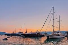 Sailing boats in marina at sunset. Royalty Free Stock Image