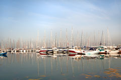 Sailing boats in marine at sunrise Royalty Free Stock Photography