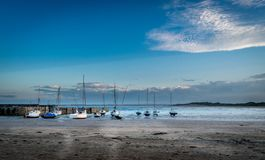 Boats or yachts moored on the beach. stock image