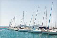Sailing boats moored in the harbor Stock Images
