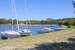 Sailing boats moored in a pier. Near the beach royalty free stock images