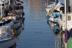 Sailing boats moored in port Stock Photos