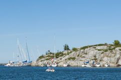 Sailing boats moored to a cliff Stockholm archipelago Stock Images