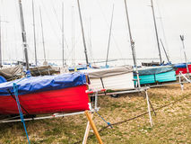 Sailing boats moored on Whitstable beach. Royalty Free Stock Photo